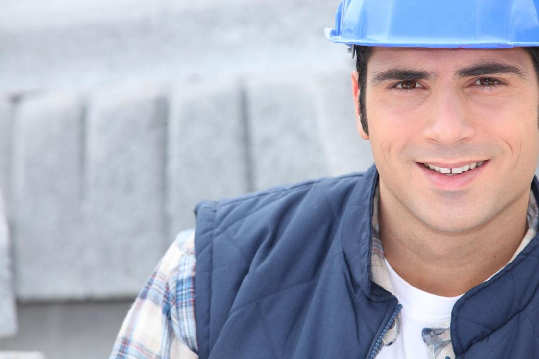 smiling construction worker posing