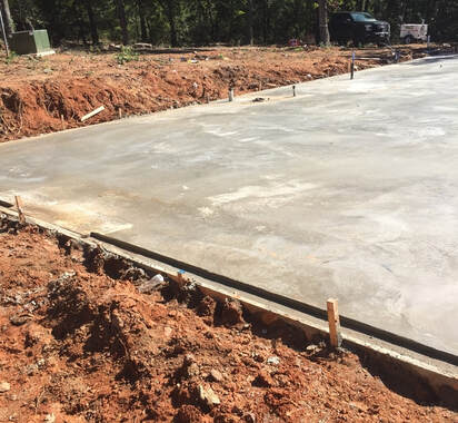 Image of freshly poured concrete foundation.