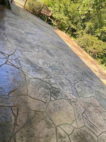 Stamped concrete patio with antique finish